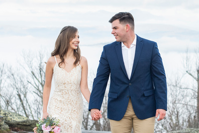 Bride and groom holding hands after elopement at Jump Off Rock wedding