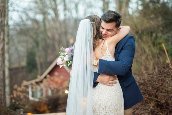 Bride and groom hugging during wedding first look in Hendersonville NC