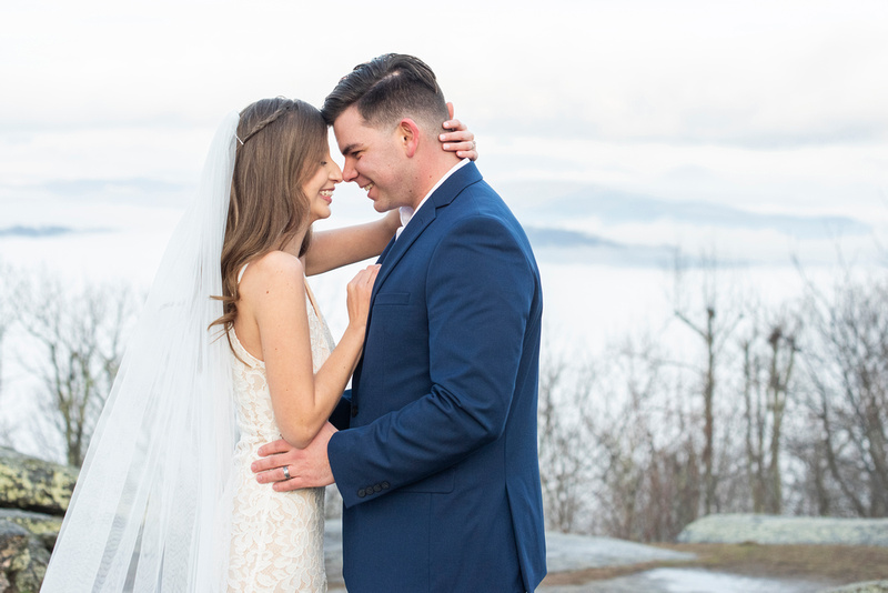 Bride and groom touching foreheads at wedding at Jump Off Rock in Laurel Park NC