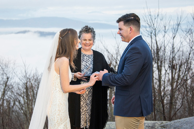Couple laughing during ring ceremony at wedding at Jump Off Rock in Laurel Park NC