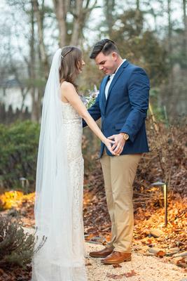 Groom looking at Bride during first look in Hendersonville NC