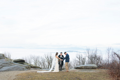Sunrise elopement with mountain views at Jump Off Rock in Laurel Park NC