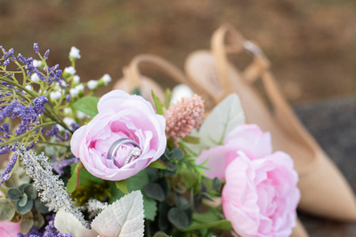 Wedding rings in bouquet at Jump Off Rock elopement near Asheville NC