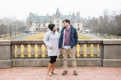 Couple engaged at Winter engagement proposal at Biltmore Estate in Asheville NC in winter