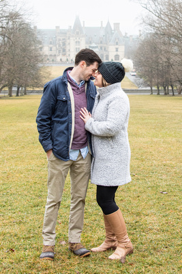 Couple touching noses after proposal at Winter engagement proposal at Biltmore Estate in Asheville NC