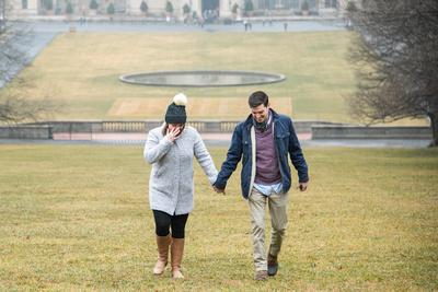 Couple walking toward me after proposal at Winter engagement proposal at Biltmore Estate in Asheville NC