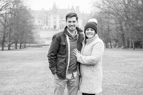 Engaged couple in front of Winter engagement proposal at Biltmore Estate in Asheville NC