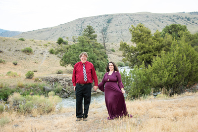 Married couple holding hands in Yellowstone National Park by Asheville family photographer