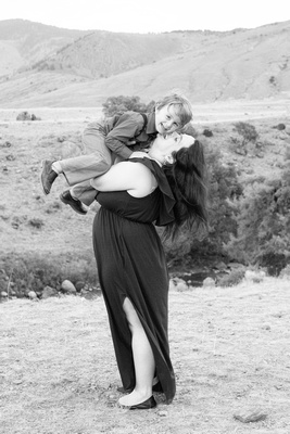 Mom kissing son on the cheek in black and white in Yellowstone National Park by Asheville family photographer
